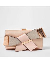 Rose gold tone purse