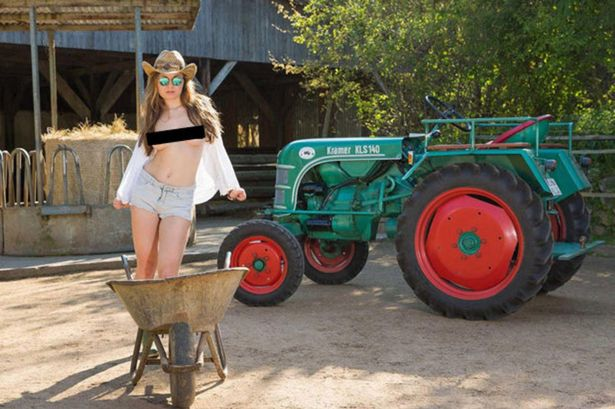 Nude farm girl naked on tractor