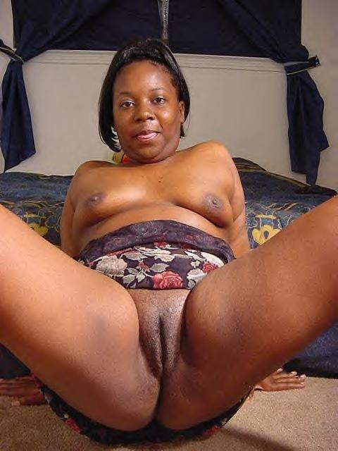 Ebony shaved pussy clean spread