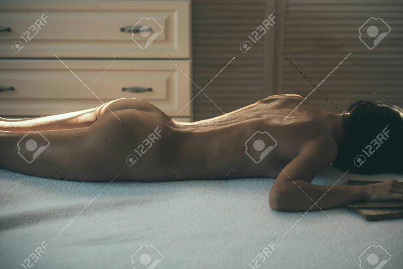 Girl naked on a massage bed