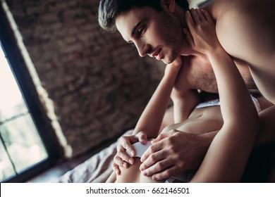 Men kissing women breast