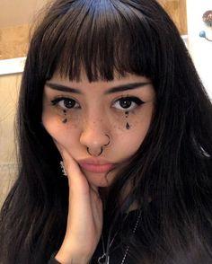 Homemade raven hair piercings