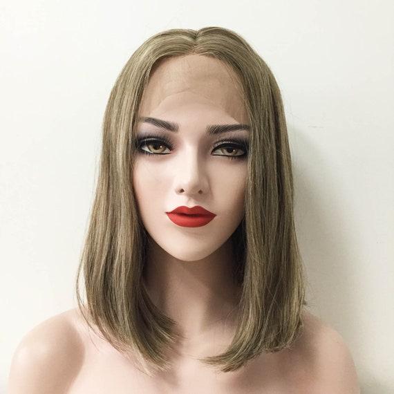 Dark ash blonde hair with brown eyes