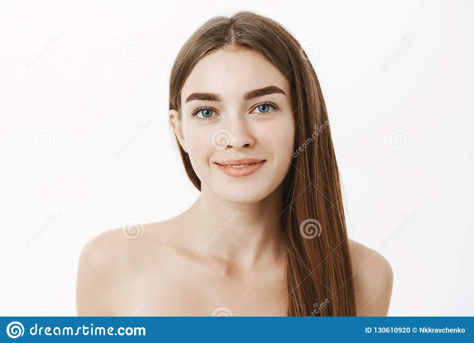 Looking up at a standing naked woman