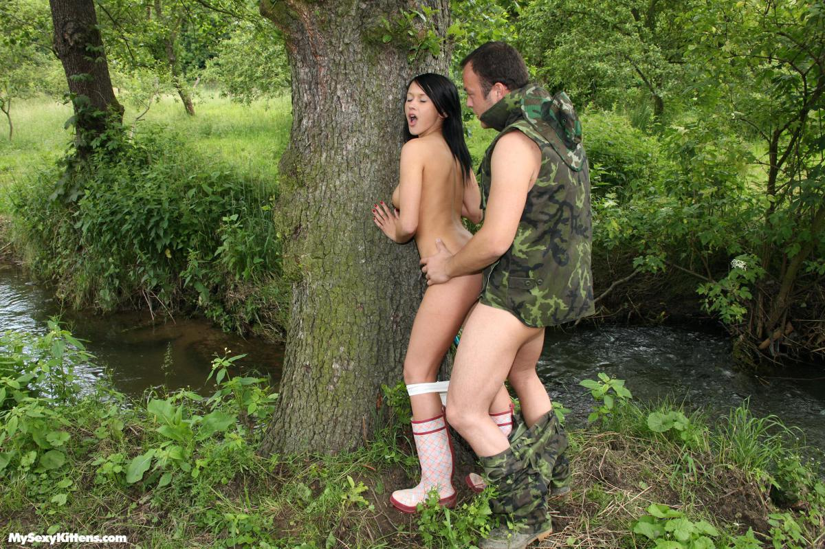 Nude woman showing ass in the jungle
